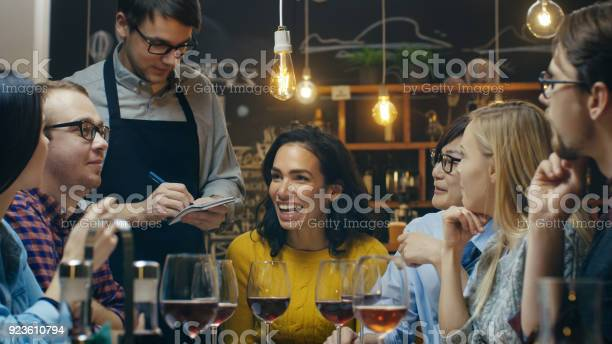 In the bar restaurant waiter takes order from a diverse group of picture id923610794?b=1&k=6&m=923610794&s=612x612&h=xr1cxmsicgtuwvp3y 5 ycfbc5xdbk9tswyjpeb4n 4=