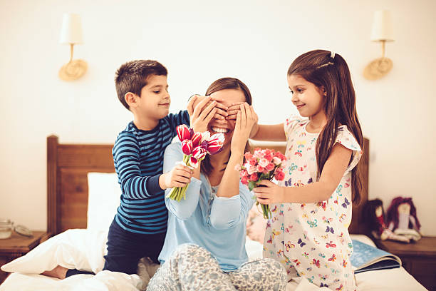 in the bedroom - mothers day stock photos and pictures