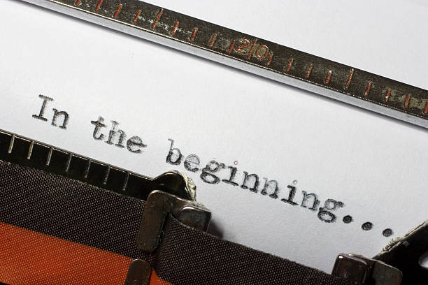 in the beginning written using old retro typewriter - creation stock photos and pictures