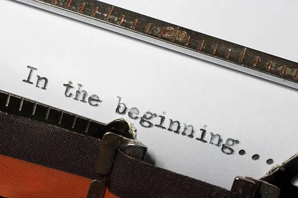 in the beginning written using old retro typewriter - schepping stockfoto's en -beelden