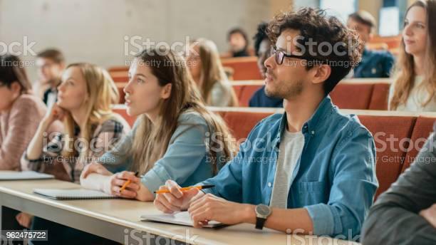 In the classroom multi ethnic students listening to a lecturer and picture id962475722?b=1&k=6&m=962475722&s=612x612&h=gu uj1iuhuqfgaldxlwygfmonpgflddlz9vrs3dmtng=