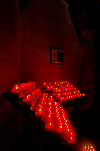 In the crypt Red candles in Holy Family crypt. 2014 stock pictures, royalty-free photos & images
