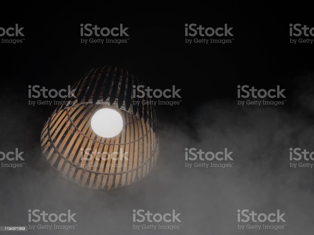 In the dark And cold, there is always light. Old bamboo lamp and fog...