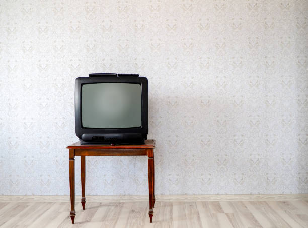 In the empty room, the old tube TV on the coffee table stock photo