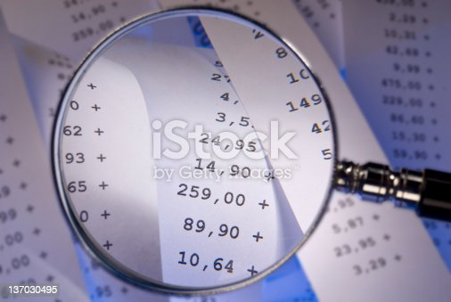 Magnifying glass with sales checks