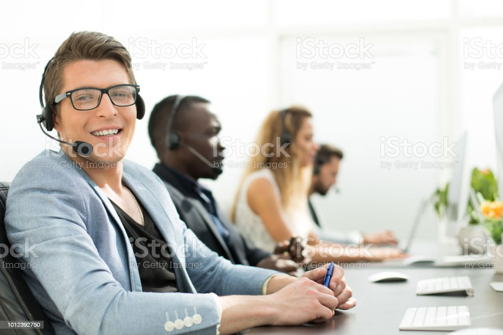 in the foreground .employee call center in the office stock photo