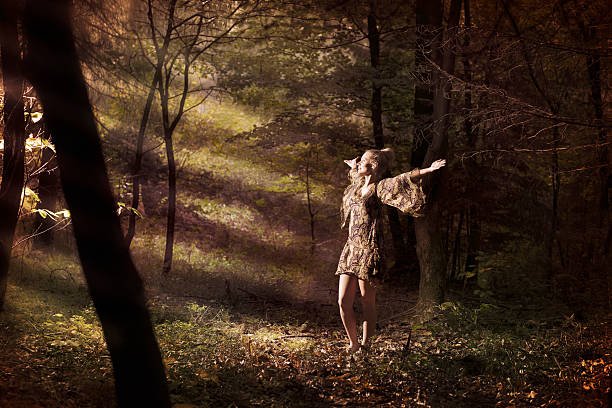 In the forest Beautiful young woman in the forest. sun shining through dresses stock pictures, royalty-free photos & images