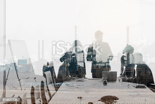 Multiple exposure shot of colleagues in a meeting superimposed over an industrial background