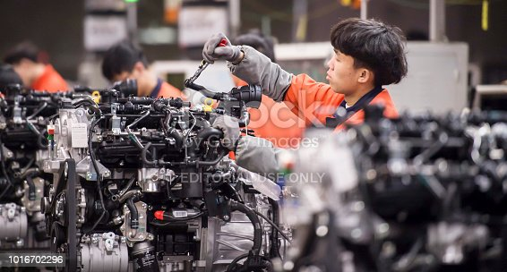 Zhejiang, China - March 23, 2017: In the Geely Automobile Factory in Linhai City, Zhejiang Province, the entire assembly line has been busy making new cars.
