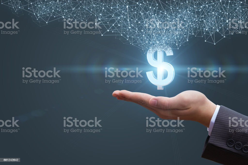 In the hands appears with a dollar sign. stock photo