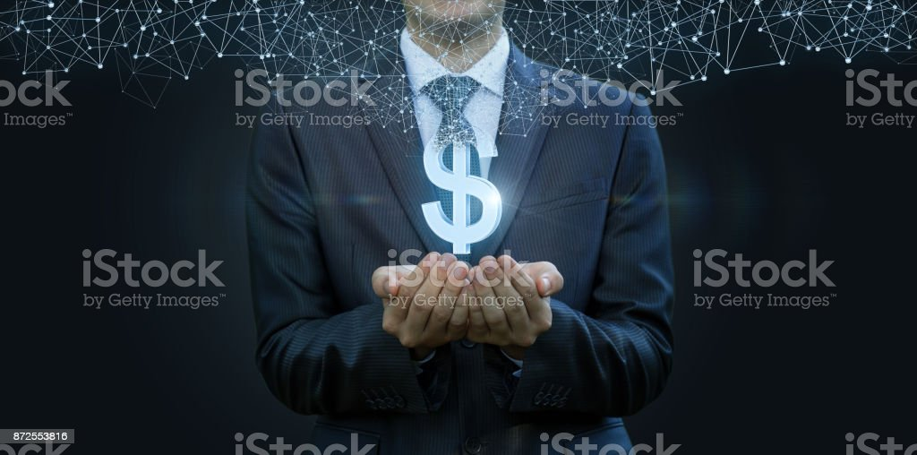 In the hands of a businessman appears the dollar . stock photo