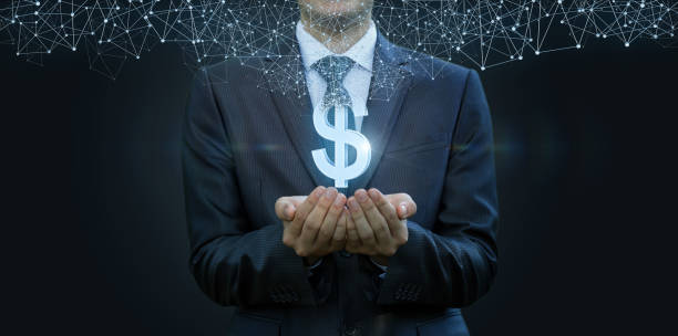In the hands of a businessman appears the dollar . In the hands of a businessman appears the dollar sign from the network connections . The concept of electronic money. miserly stock pictures, royalty-free photos & images