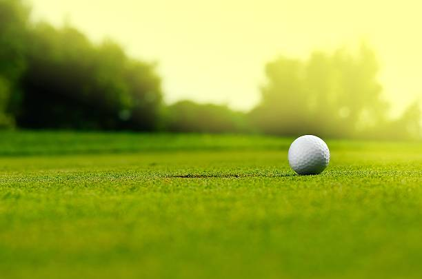 in the hole - golf stock photos and pictures