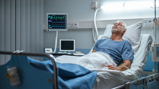1049772134 istock photo In the Hospital Senior Patient Rests, Lying on the Bed. Recovering Man Sleeping in the Modern Hospital Ward. 1043174762