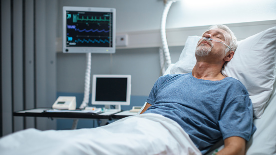 1049772134 istock photo In the Hospital Senior Patient Rests, Lying on the Bed. Recovering Man Sleeping in the Modern Hospital Ward. 1043174784