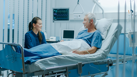 1049772134 istock photo In the Hospital Senior Patient Rests, Lying on the Bed. Recovering Man Sleeping in the Modern Hospital Ward. 1043174804
