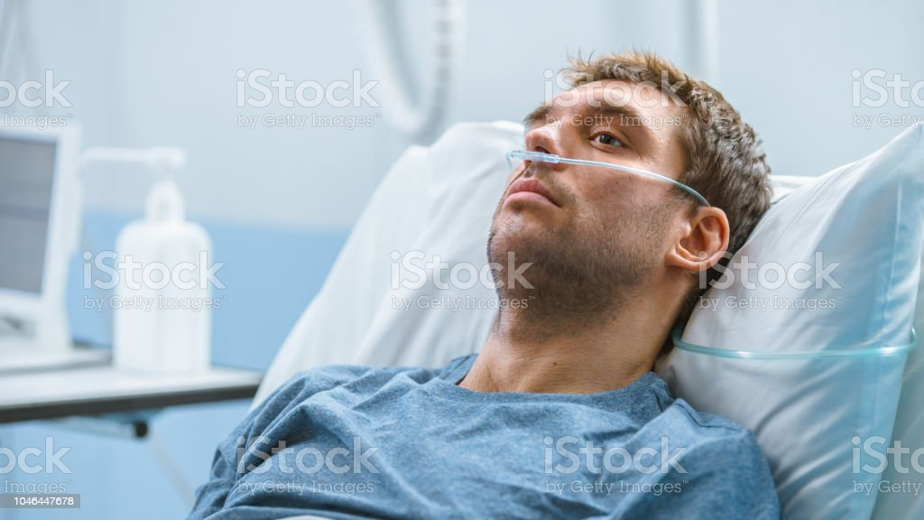 In The Hospital Sick Male Patient Lying On The Bed Hes Wearing Nasal