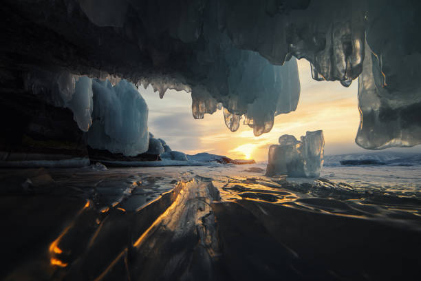 In the ice cave at sunset stock photo
