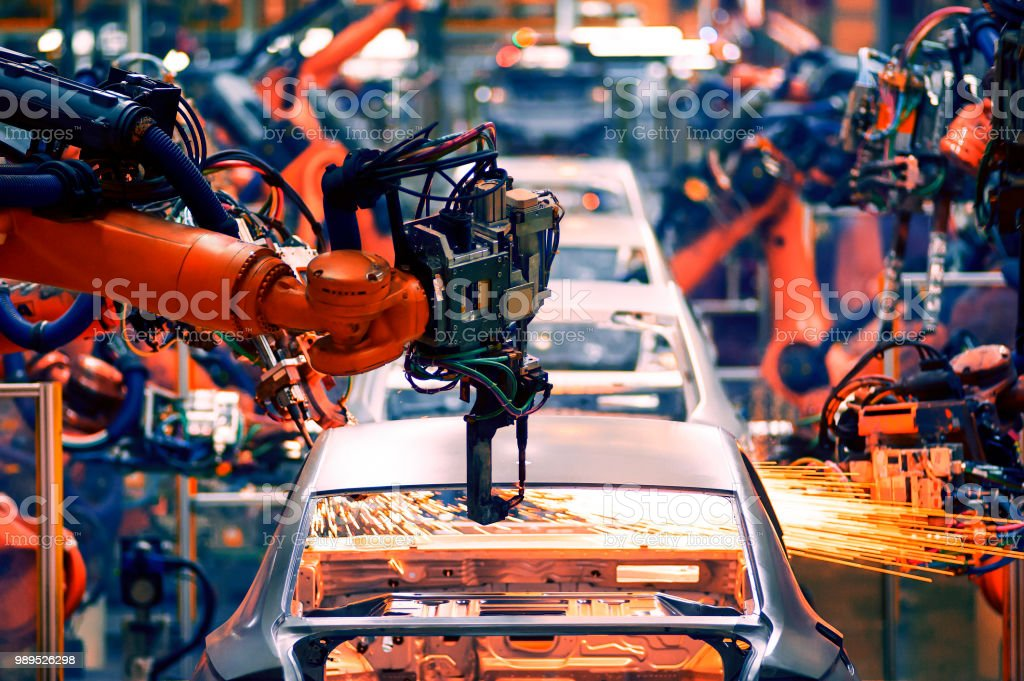 In the industrial production workshop, the robot arm of the...