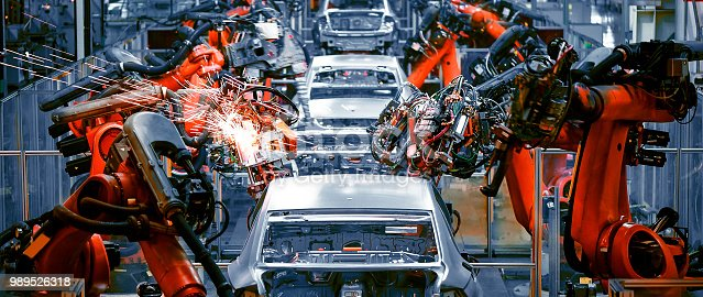 istock In the industrial production workshop, the robot arm of the automobile production line is working 989526318