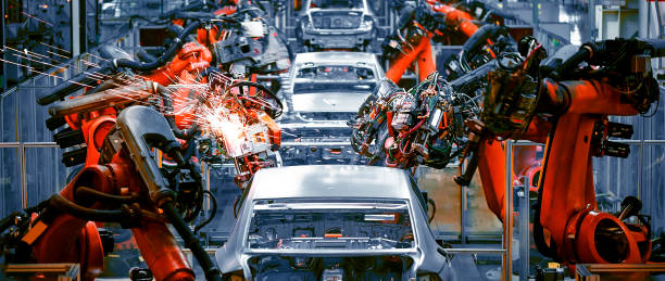 In the industrial production workshop, the robot arm of the automobile production line is working stock photo