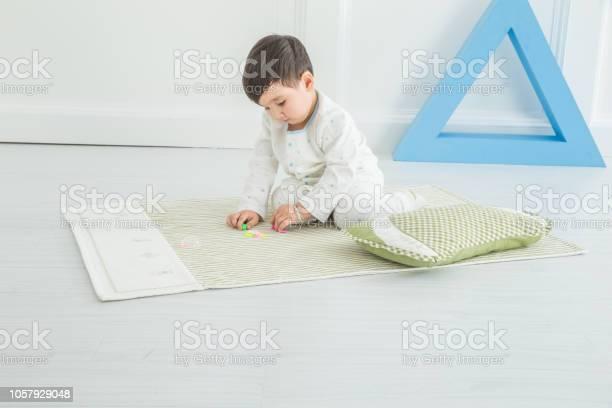 In the kindergarten a cute little boy was sitting on the floor picture id1057929048?b=1&k=6&m=1057929048&s=612x612&h=rqsopnz mqui t9gqrdgjtlaonjdxveqv9yl5fvnpxu=