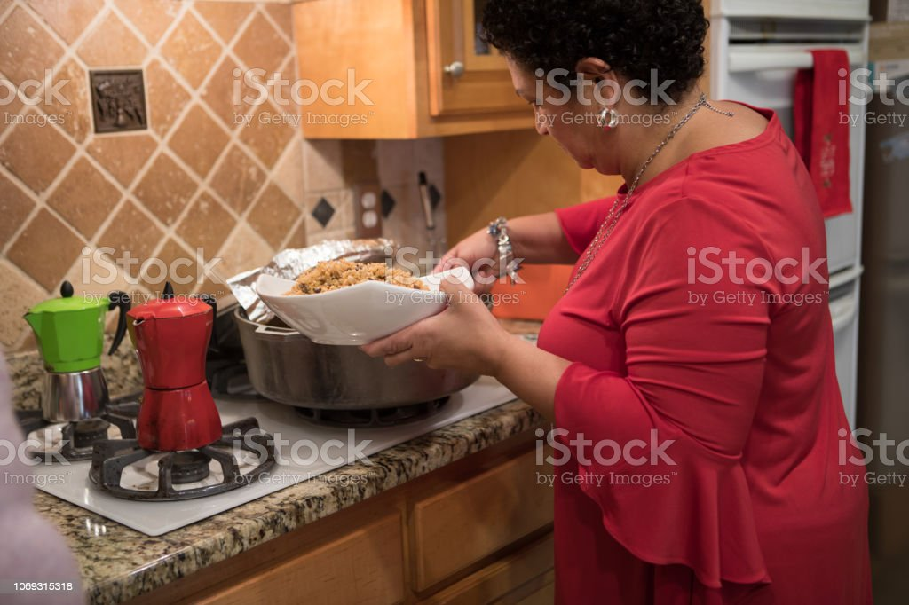 in the kitchen serving food stock photo