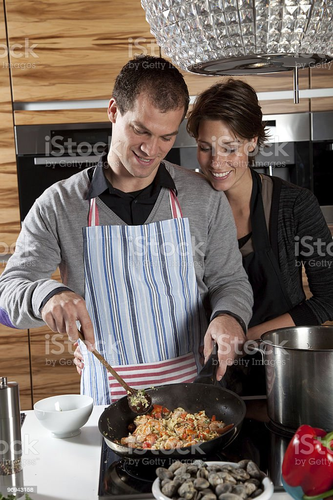 In the kitchen together royalty-free stock photo