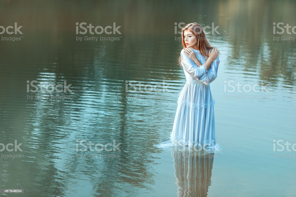 In the middle lake there is a girl. stock photo