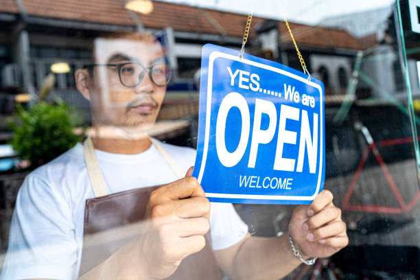 in the morning, the owner of a small business shop came to open the shop. - open sign stock pictures, royalty-free photos & images