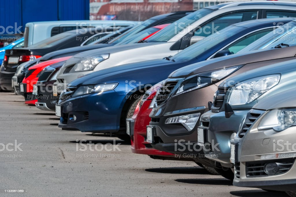 In the Parking lot. View of the front of the cars parked in a row in the city Parking lot. Asphalt Stock Photo