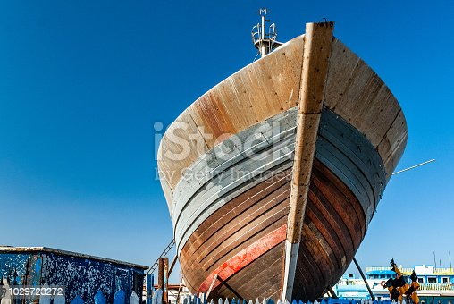 Repairs on the bow of a fishing boat in dry dock at the port of Essaouira in Morocco