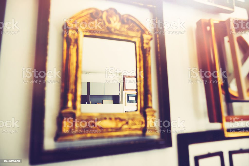 In the realm of picture frames - many old picture frames in a frame...