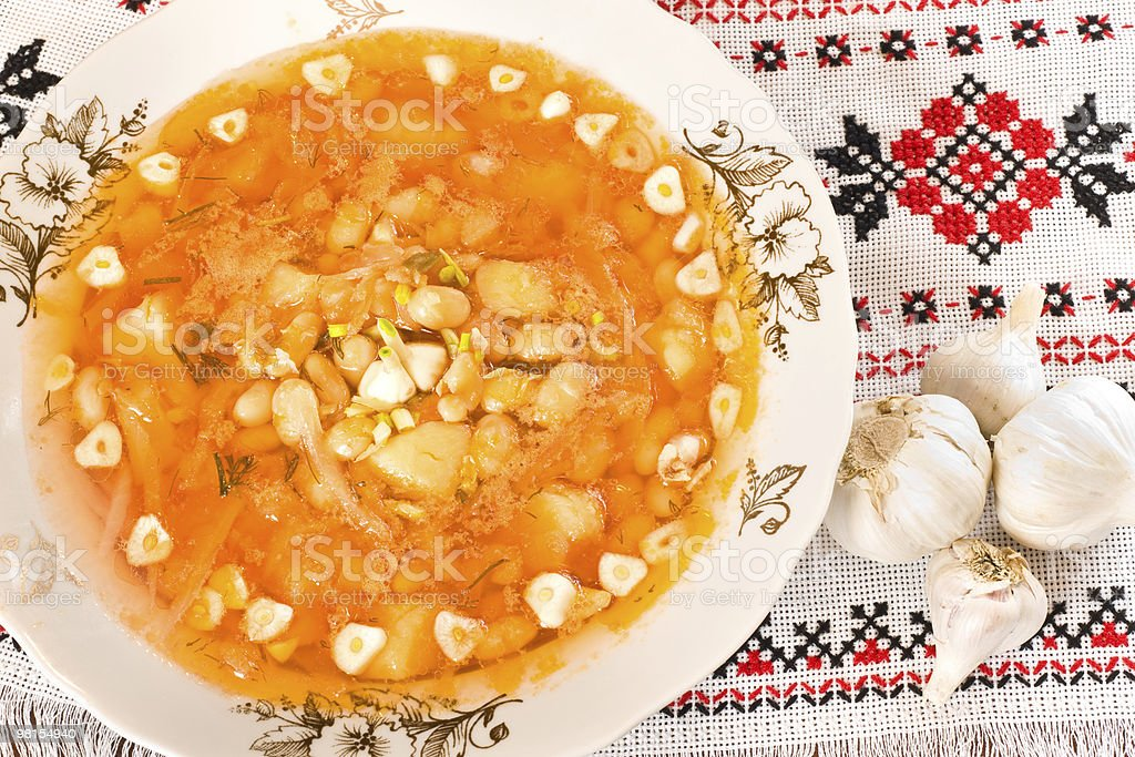 In the restaurant - borsch and garlic heads royalty-free stock photo