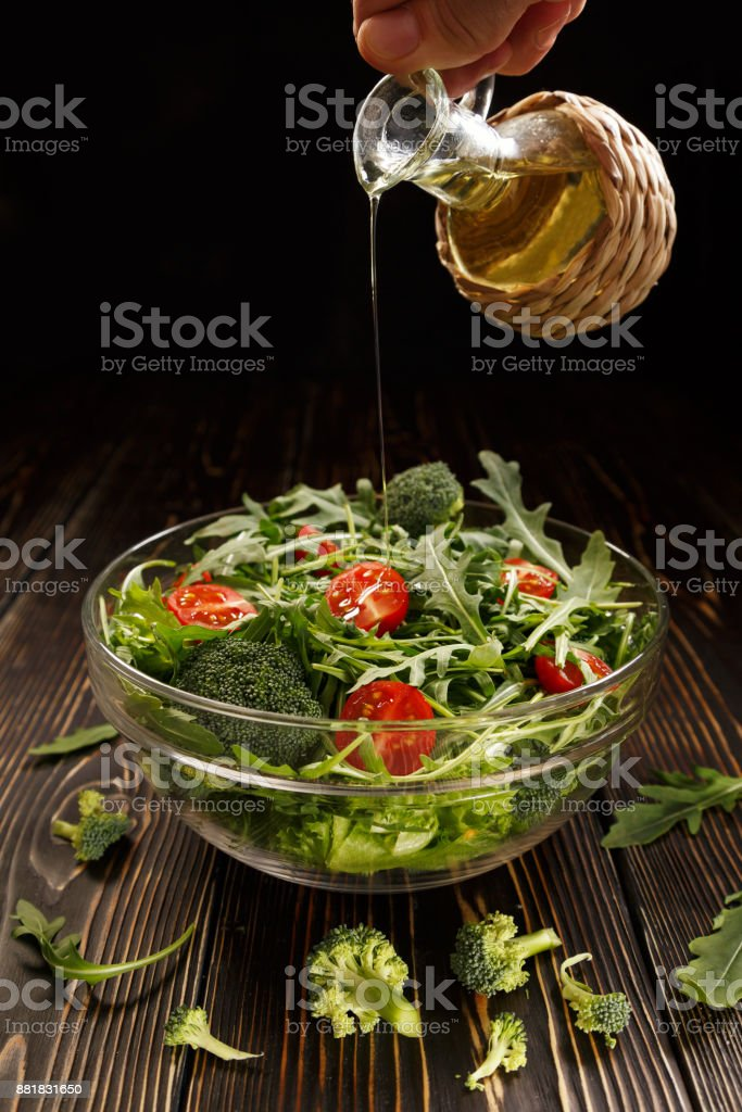 In the salad pour the vegetable oil stock photo
