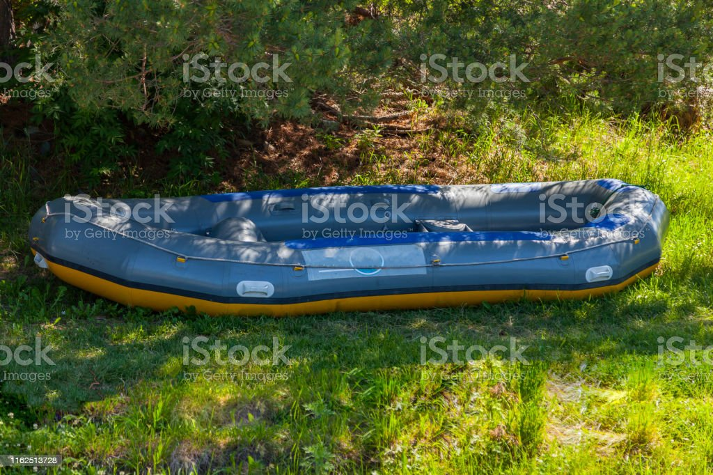In The Shade Under The Trees Large Inflatable Rafting Boat ...