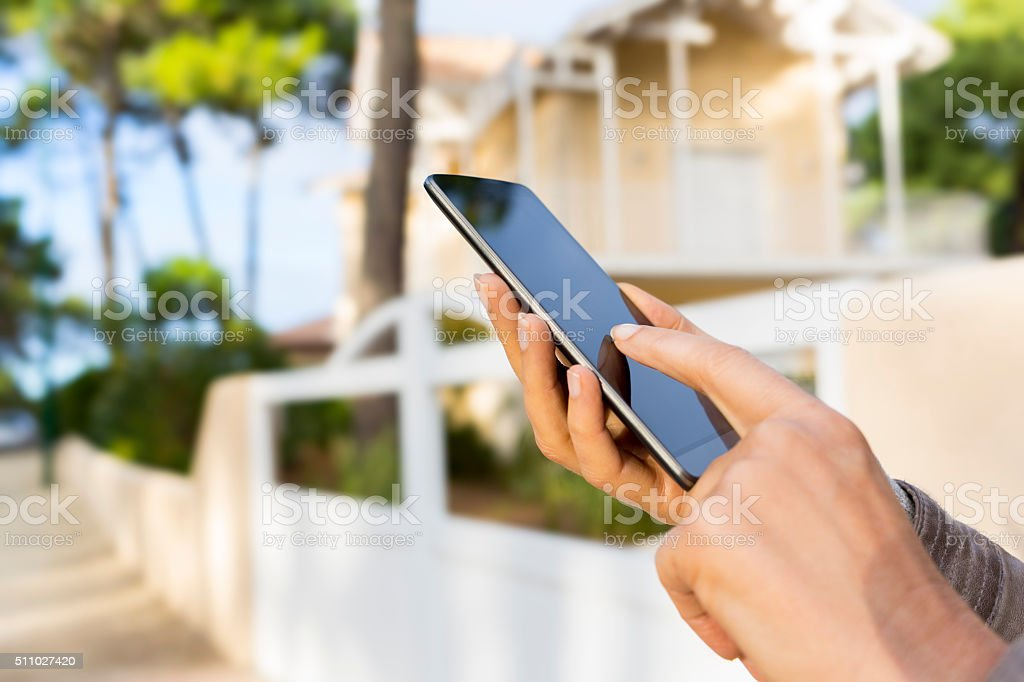 In the street woman using application mobile phone. stock photo