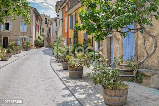 Narrow street leading up to the church in Cucuron, Provence, Luberon, Vaucluse,  France