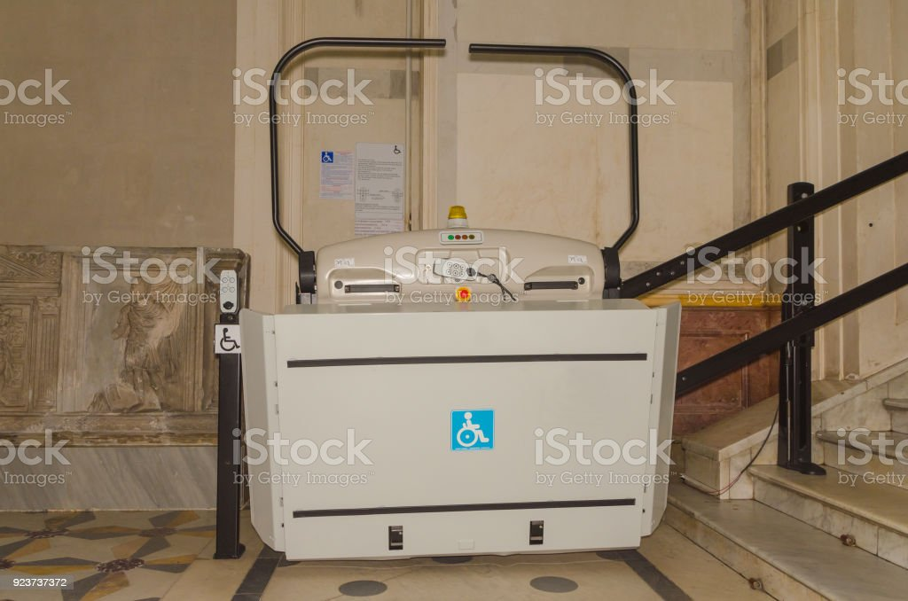 in the transition to the stairs lift for disabled wheelchair users stock photo