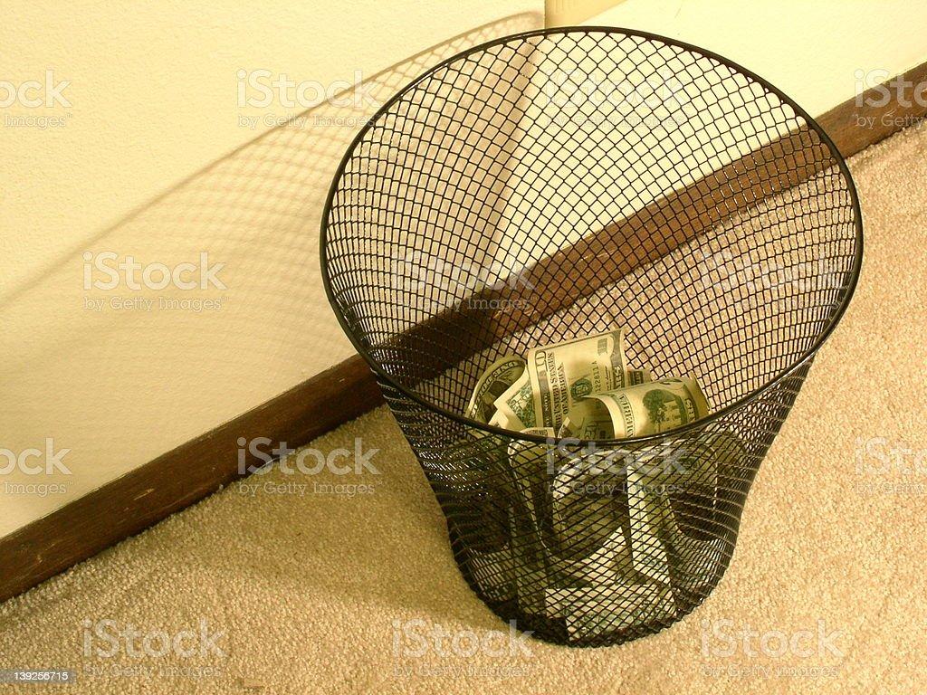 MONEY in the wastebasket! stock photo
