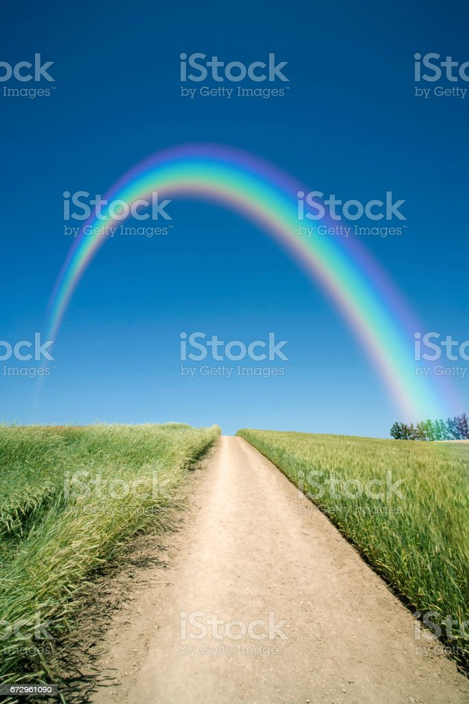 In the Wheatfield road and Rainbow stock photo