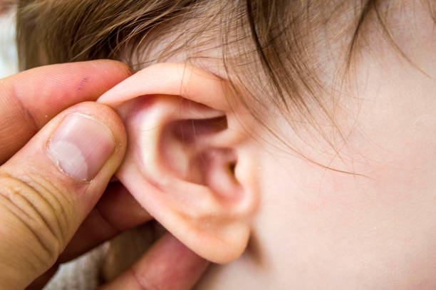 In the winter months, children's ears become more inflamed, middle ear inflammation in infants and doctors treatment stock photo