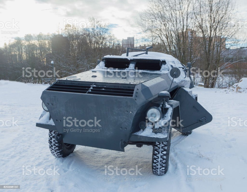 in the winter on a snowy road, a German armored car stock photo