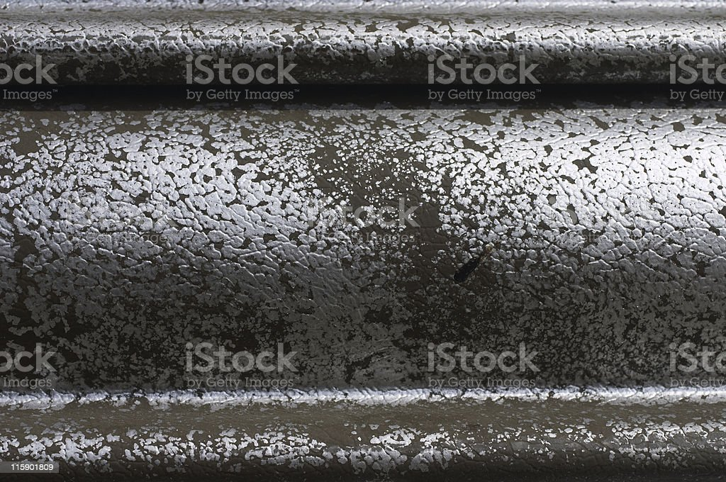 Graffiti abstract silver paint sprayed onto metal garage door stock photo