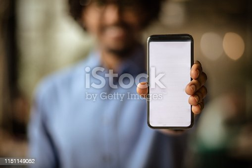 In today's time without technology there is no progress in anyone. Business man holding smart phone.