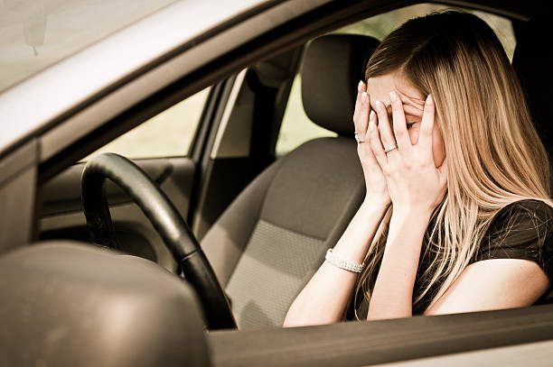 In troubles - unhappy woman in car stock photo