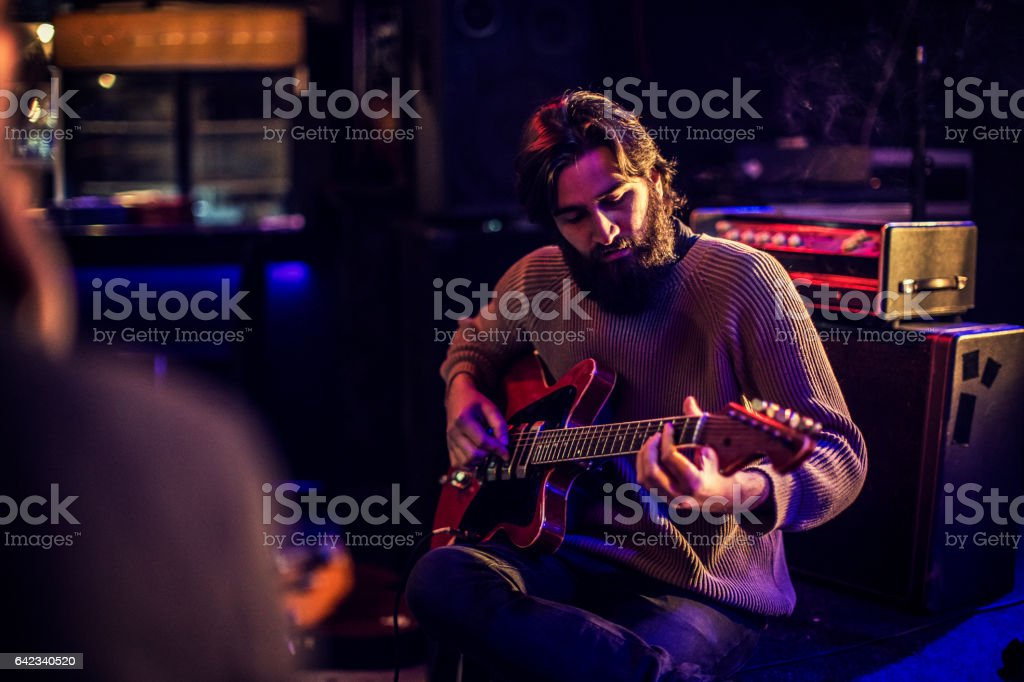 In tune with his guitar stock photo