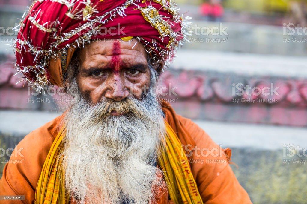In Varanasi, a serious Indian sadhu looking at the camera. stock photo
