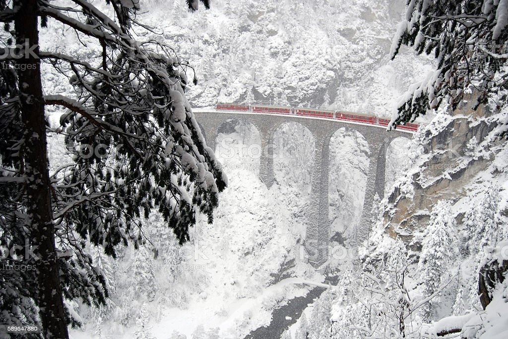 In winter conditions a train on the Landwasser viaduct. stock photo