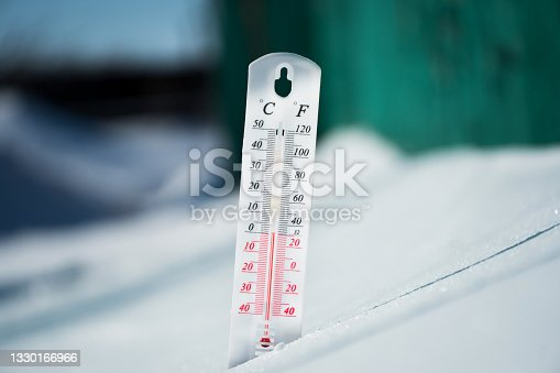 istock In winter or spring the thermometer lies on the snow and shows a negative temperature in cold weather.Meteorological conditions with low air and ambient temperatures.Climate change and global warming 1330166966